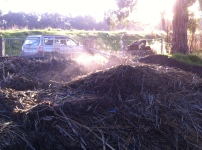 The compost is steaming five days after the build. And you can definitely smell it transforming. Lovely composting!
